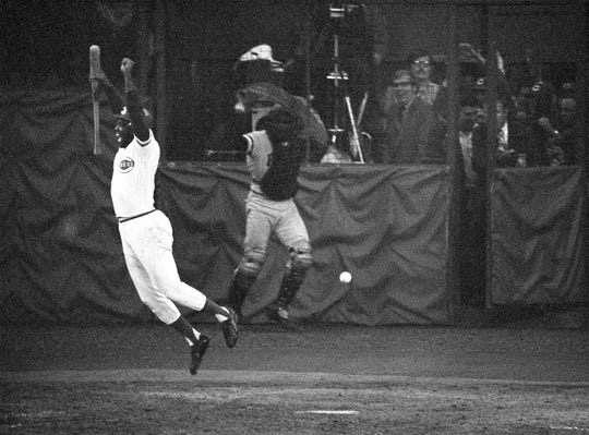 Cincinnati Reds' Hal McRae jumps out of the way of a wild pitch from Pittsburgh Pirates Bob Moose in the bottom of the ninth inning in the final game of the National League playoff at Cincinnati, Oct. 11, 1972.  Pirates' catcher Manny Sanguillen chase the ball. The Reds are going to the World Series.