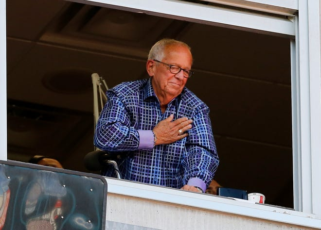 Retiring Reds broadcaster Marty Brennaman waves to a standing ovation as he prepares to call his final inning in the ninth inning of the MLB National League game between the Cincinnati Reds and the Milwaukee Brewers at Great American Ball Park in downtown Cincinnati on Thursday, Sept. 26, 2019. The Reds lost the final home game of the season, 5-3.