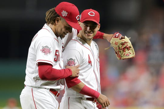 Cincinnati Reds starting pitcher Luis Castillo (58) embraces shortstop Jose Iglesias (4) as they walk off the field in the seventh inning of an MLB baseball game against the Los Angeles Angels, Monday, Aug. 5, 2019, at Great American Ball Park in Cincinnati.