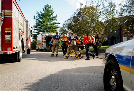 Clarksville Fire Rescue, Police, and MCEMS officers evacuate a man on a stretcher that was found unconscious down a hill near the cliffs overlooking the Cumberland River at Queens Bluff Neighborhood in Clarksville, Tenn., on Friday, Sept. 27, 2019.