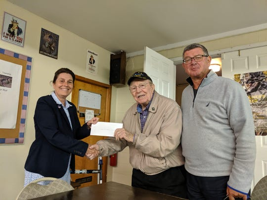 The North Brunswick Remembers Committee, which is dedicated to honor veterans and Elmwood Cemetery,present the North Brunswick American Legion Post 459 a check from funds raised through last year' s National Program, Wreaths Across America. Elmwood Cemetery has been approved as an official site for 2019 and their goal is to place 650 wreaths at the grave sites of Veterans with a donation for every wreath bought going to the American Legion Post 459.More information to support Wreaths Across America by going to the Elmwood Cemetery website athttps://theelmwoodcemetery.com/or call 732-545-1445 or go towww.wreathsacrossamerica.org.
