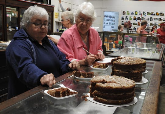 Becky Jewell of Zanesville served as a baked goods judge with Dorothy Dalton recording results Friday at the Coshocton County Fair in the Art Hall.