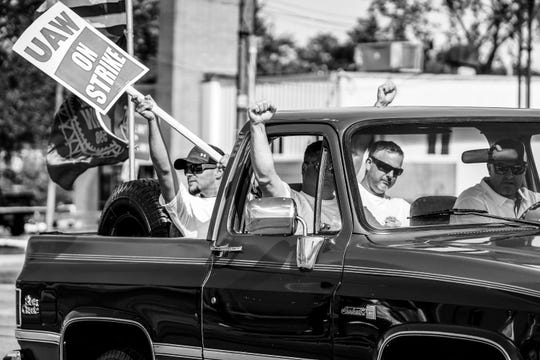 A truck full of UAW members show support for other UAW members on strike against General Motors outside of Flint Assembly as they drive along Van Slyke Rd. in Flint on Tuesday, September 24, 2019