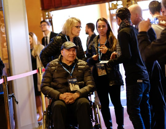 """Former Detroit Red Wing Vladimir Konstantinov arrives before the start of the world premiere of """"The Russian Five"""" during the opening night for the Freep Film Festival at The Fillmore in downtown Detroit on Wednesday, April 11, 2018."""