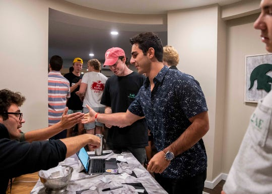 Human biology sophomore Charlie Toma is greeted by Sigma Alpha Epsilon fraternity brothers during Greek Rush on Thursday Sept. 26, 2019 in East Lansing.