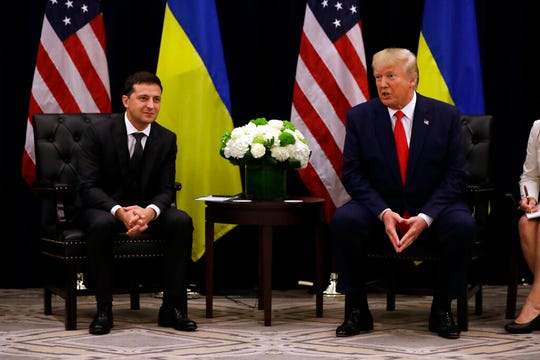 President Donald Trump meets with Ukrainian President Volodymyr Zelenskiy during the United Nations General Assembly, Wednesday, Sept. 25, 2019, in New York. German officials are pushing back against suggestions by Trump that Berlin does little for Ukraine.