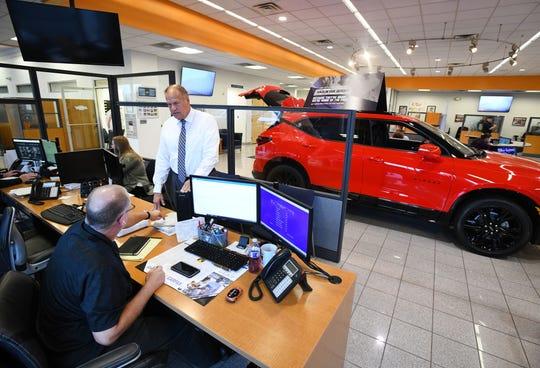 Matthews Hargreaves Chevrolet general manager Walt Tutak talks with general sales manager Rick Resinger at the dealership in Royal Oak, Michigan on September 27, 2019.