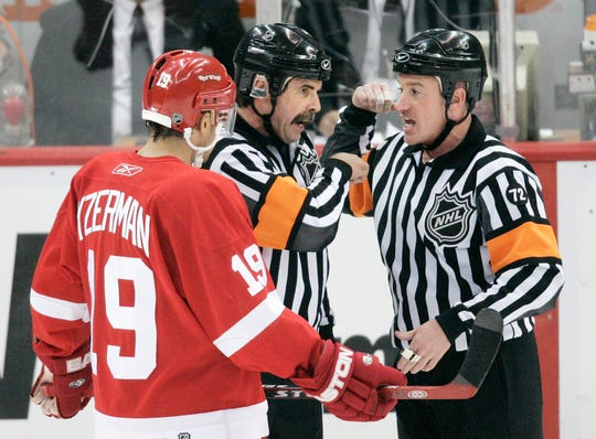 Red Wings captain Steve Yzerman, left, listens to referees Bill McCreary, center, and Kelly Sutherland during Game 1 of the 2006 playoffs against the Edmonton Oilers at Joe Louis Arena. Detroit's Kirk Maltby received two minutes for interference and Edmonton goalie Dwayne Roloson was given a two-minute minor for slashing. The Wings won 3-2 in double overtime.