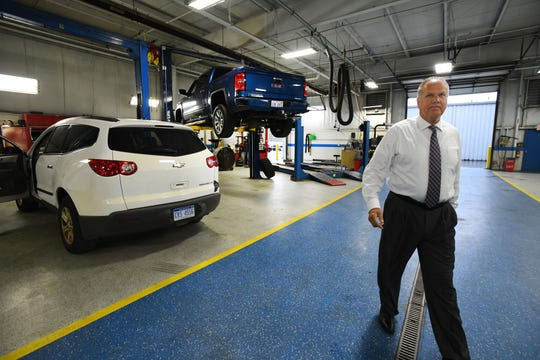 Matthews Hargreaves Chevrolet general manager Walt Tutak walks through the shop, where concerns of part deficiencies due to the strike, could keep cars on the lifts at the dealership in Royal Oak, Michigan on September 27, 2019.