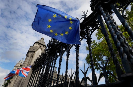A European Union flag is tied on the railings of Britain's Parliament in London, Friday, Sept. 27, 2019.