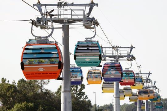 Gondolas move to various locations at Walt Disney World on the Disney Skyliner aerial tram.
