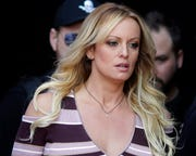 In this Oct. 11, 2018, file photo, adult film actress Stormy Daniels arrives for the opening of the adult entertainment fair Venus in Berlin. Columbus, Ohio has reached a $450,000 settlement with Stormy Daniels over the porn actress' arrest at a strip club last year.
