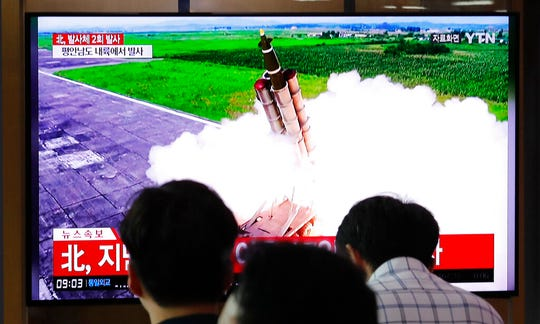 People watch a TV showing a file image of an unspecified North Korea's missile launch during a news program at the Seoul Railway Station in Seoul, South Korea, Tuesday, Sept. 10, 2019.