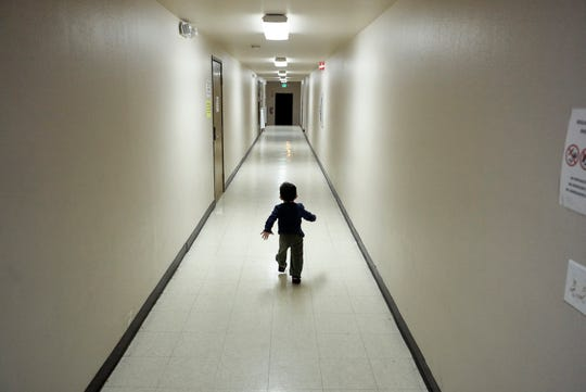 In this Dec. 11, 2018 file photo, an asylum-seeking boy from Central America runs down a hallway after arriving from an immigration detention center to a shelter in San Diego.