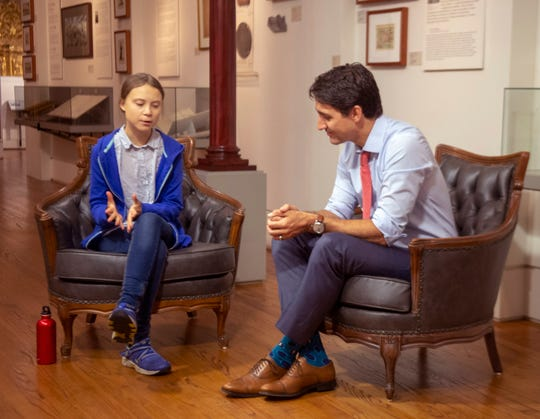 Canadian Prime Minister Justin Trudeau speaks Swedish environmental activist Greta Thunberg in Montreal on Friday, Sept. 27, 2019.