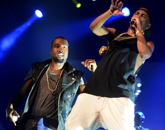 Detroit Rapper Big Sean, right, and rapper Kanye West perform live on stage on December 1, 2012, at the Palace of Auburn Hills.