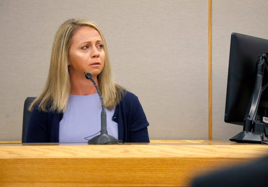 Fired Dallas police officer Amber Guyger becomes emotional as she testifies in her murder trial, Friday, Sept. 27, 2019, in Dallas.