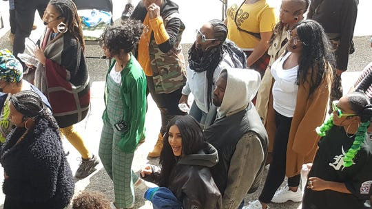 """Kanye West, Kim Kardashian West and their children walk into the Aretha Franklin Amphitheatre before his """"Sunday Service"""" concert in Detroit."""