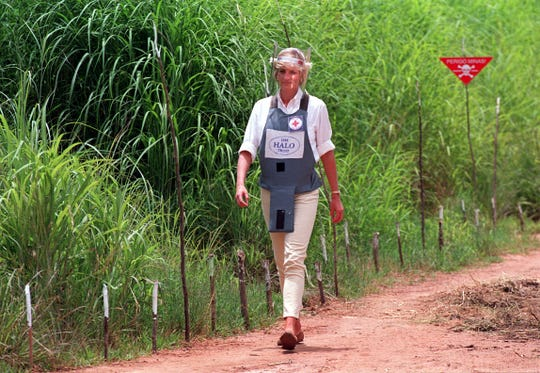 Princess Diana, wearing a bombproof visor, visits a minefield in Huambo, in Angola on  Jan. 15, 1997.