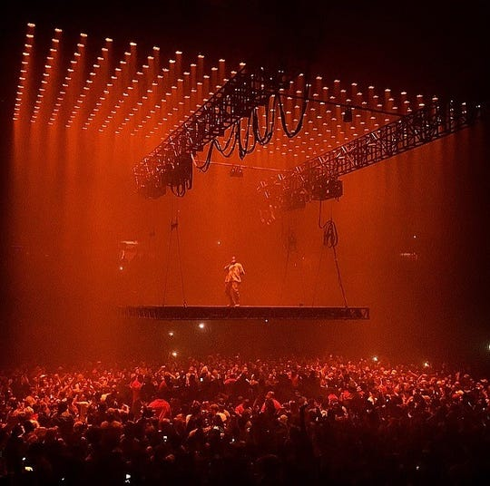 Kanye West performs at the Joe Louis Arena stop of his Saint Pablo tour.