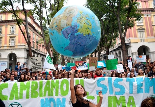 Students demonstrate during a worldwide protest demanding action on climate change, in Turin, northern Italy, Friday, Sept. 27, 2019.