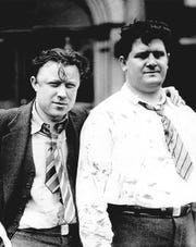"""Walter Reuther, left, president of UAW Local 174, and Richard Frankensteen, UAW-CIO, are bloodied after being beaten by Ford employees in the """"Battle of the Overpass,"""" May 26, 1937."""