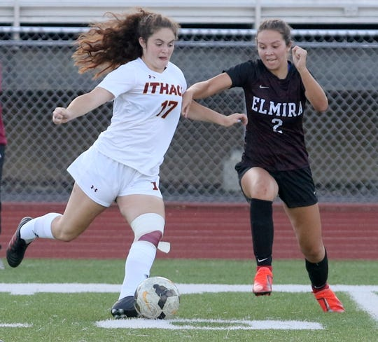 Ithaca's Alecia Nicholas gets set to kick the ball as Elmira's Bryanna Henley closes in during Elmira's 2-1 win in girls soccer Sept. 26, 2019 at Ernie Davis Academy in Elmira.