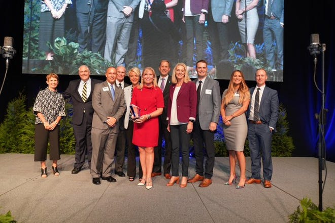 Southwest Indiana Chamber Board Chair Christine Keck (center) presents Old National Bank officials with the chamber's 2019 Business of the Year award.