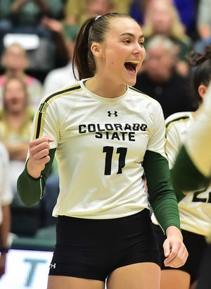 Colorado State volleyball player Paulina Hougaard-Jensen celebrates in a match earlier this season. She had a double-double in a win over Utah State on Saturday on the road.