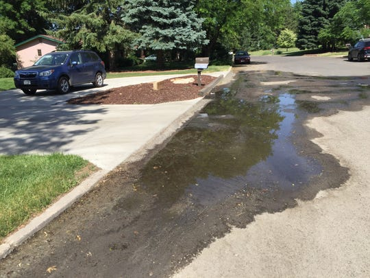 Water pools on Miramont Drive in Country Club Estates in summer 2018.
