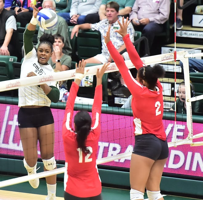 CSU volleyball Breana Runnels spikes over two New Mexico blockers for a kill during a Sept. 26 win over New Mexico at Moby Arena. The Rams travel to Laramie, Wyo., for a 6:30 p.m. match Tuesday against Wyoming.