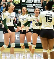 Colorado State volleyball players, from left, Paulina Hougaard-Jensen, Sasha Colombo, Katie Oleksak and Breana Runnels celebrate a point during a three-set win over New Mexico on Sept. 26, 2019, at Moby Arena. The 14th-ranked Rams swept visiting San Jose State on Thursday night to run their winning streak to 18 straight matches.