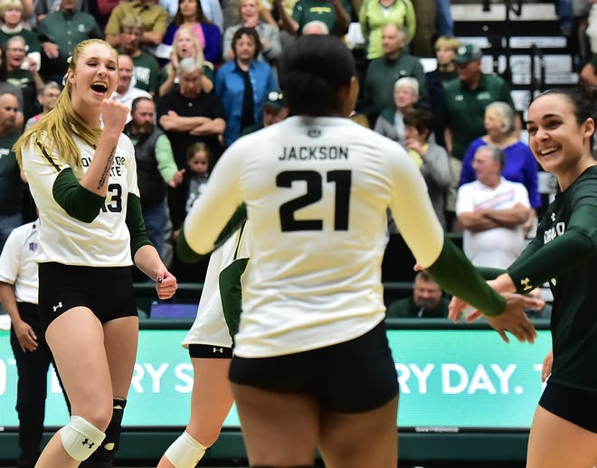 CSU volleyball player Kirstie Hillyer, left, shown in a match earlier this season. Hillyer led the Rams in kills and hitting percentage in Saturday's win over San Diego State.