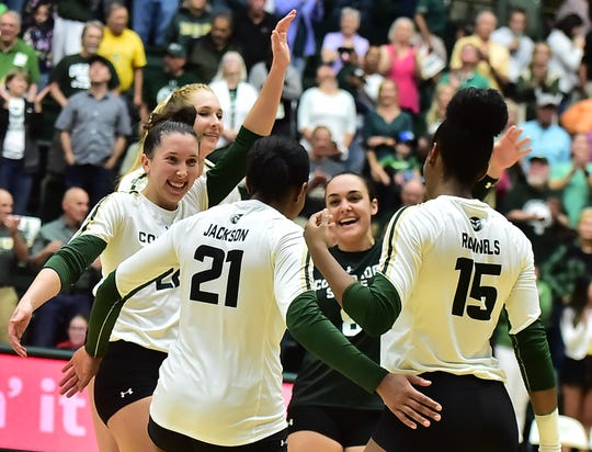 Colorado State volleyball players celebrate after the final point of a three-set sweep of New Mexico on Thursday, Sept. 26, 2019, at Moby Arena.