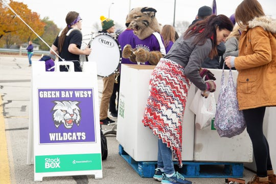 Green Bay West High School students collect food donations during the 2018 Stock the Box for Hunger contest. Green Bay's four public high schools compete each fall to see which school's band can raise the most food donations for Feeding America Eastern Wisconsin.