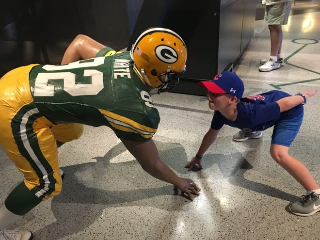 John McEnaney, 9, made his first visit to Lambeau Field in August during a tour of Wisconsin with his grandparents. He lost his camera at the stadium. When his mom asked Packers fans on Facebook for their help to find it, the response has been overwhelming.