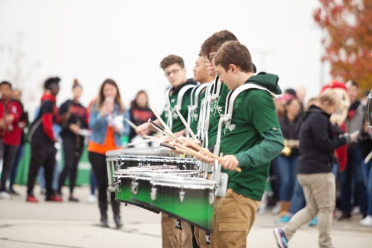 A drum line performs at the 2018 Stock the Box for Hunger campaign at Lambeau Field.