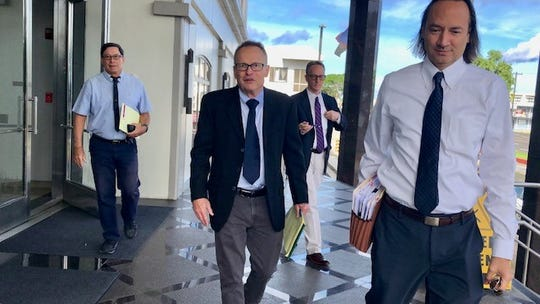 Some attorneys for plaintiffs and defendants in Guam's clergy sex abuse cases exit the U.S. District Court of Guam Building on Sept. 27, 2019 after a status conference, while other counsels are currently in San Francisco for settlement talks with the Capuchin Franciscans, Sisters of Mercy and Boy Scouts of America.