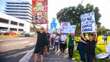A wave is held on Sept. 27, 2019 in support of the Global Climate Strike movement to raise awareness internationally to push for environmental improvements for a more sustainable future.