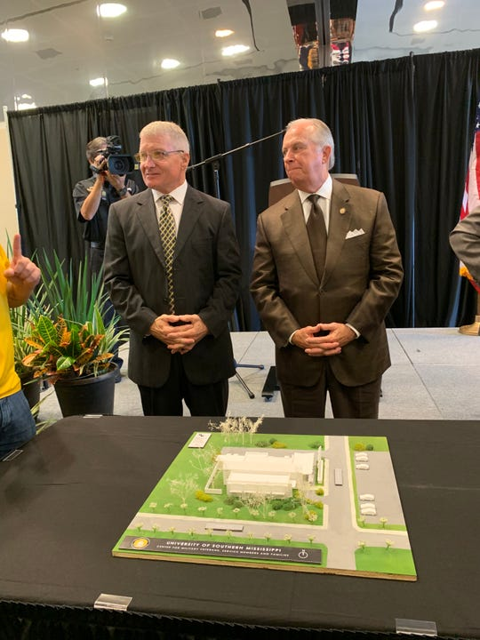 Retired Gen. Jeff Hammond, left, and University of Southern Mississippi supporter Joe Quinlan talk Friday, Sept. 27, 2019, about the Quinlan-Hammond Hall of Honor that will be used to help veterans and military students.