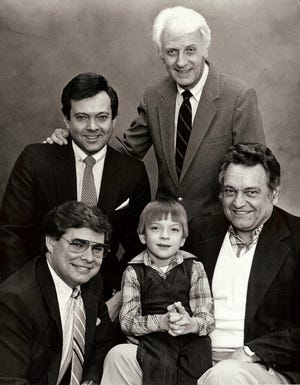 Brod Seymour (standing at right), an original member of the staff that started WEHT in Henderson in 1953, poses for an early Easter Seals Telethon promotional photo with newscaster Brad Byrd (upper left), sportscaster Bill Weber (lower left, who went on to become a NASCAR commentator on NBC and TNT) and child and adult  representatives of Easterseals. WEHT launched the telethon fundraiser in 1977; the 2019 event raised more than $1 million for Easterseals for the eighth consecutive year.