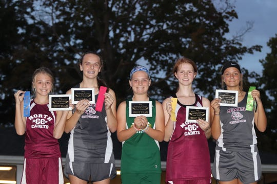 First team all-country middle school girls were Allinna Decker, North;  Allison Lucas, South; Abby Shires, Holy Name;  Mackenzie Webb, North; Destany Pike, South.