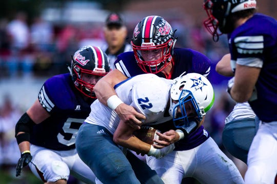 West Branch's Jeff Bowie (62) tackles Bellevue's Jacob Waller (22) during a Class 1A varsity football game, Thursday, Sept., 26, 2019, at the Little Rose Bowl in West Branch, Iowa.