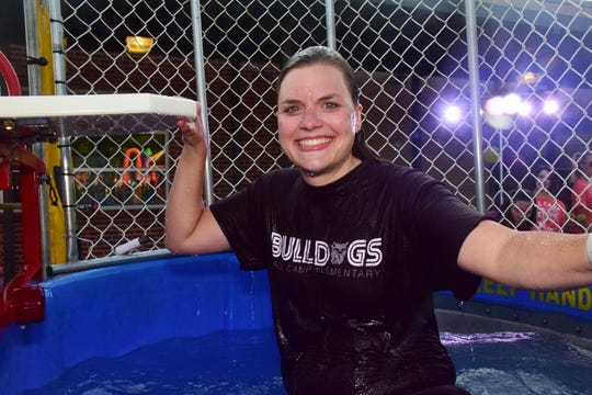 Kindergarten teacher Mallory Carusone seems to be a good sport in the dunk tank at the annual Fall Carnival held at Ball Camp Elementary School Friday, Sept. 20.