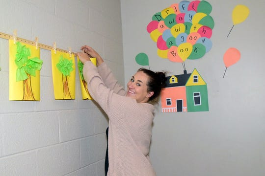 Sadie Anderson assembles a display for her students at PEER Academy Thursday, Sept 26.