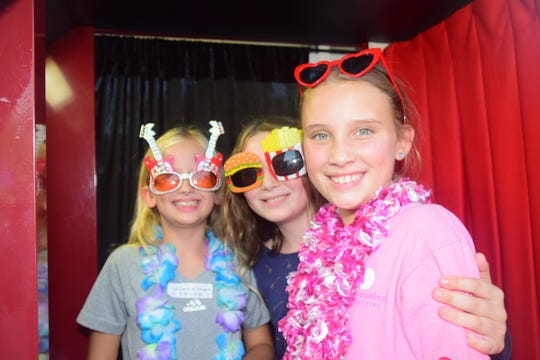 Annabelle Swindle, 10, Lilly Abner, 10, and Josie Mattmann, 10, capture the moment in the Keepsake Photobooth at the annual Fall Carnival held at Ball Camp Elementary School. 9/2019