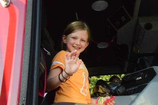 Parker Raths, 8, explores a fire engine at the annual Fall Carnival held at Ball Camp Elementary School.