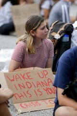 Students and community members listen to student speakers during a climate strike rally outside Happy Hollow School, Friday, Sept. 27, 2019, in West Lafayette. About 300 students and community members marched from West Lafayette Jr./Sr. High School to the West Lafayette library and then to Happy Hollow School calling for climate change action.