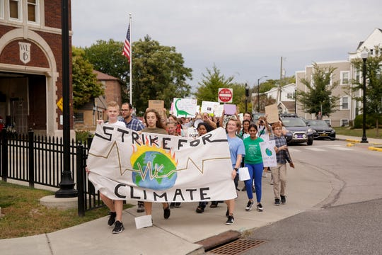 Students walk from West Lafayette Jr./Sr. High School to the city library during climate change strike, Friday, Sept. 27, 2019, in West Lafayette. About 300 students and community members marched from West Lafayette Jr./Sr. High School to the West Lafayette library and then to Happy Hollow School calling for climate change action.