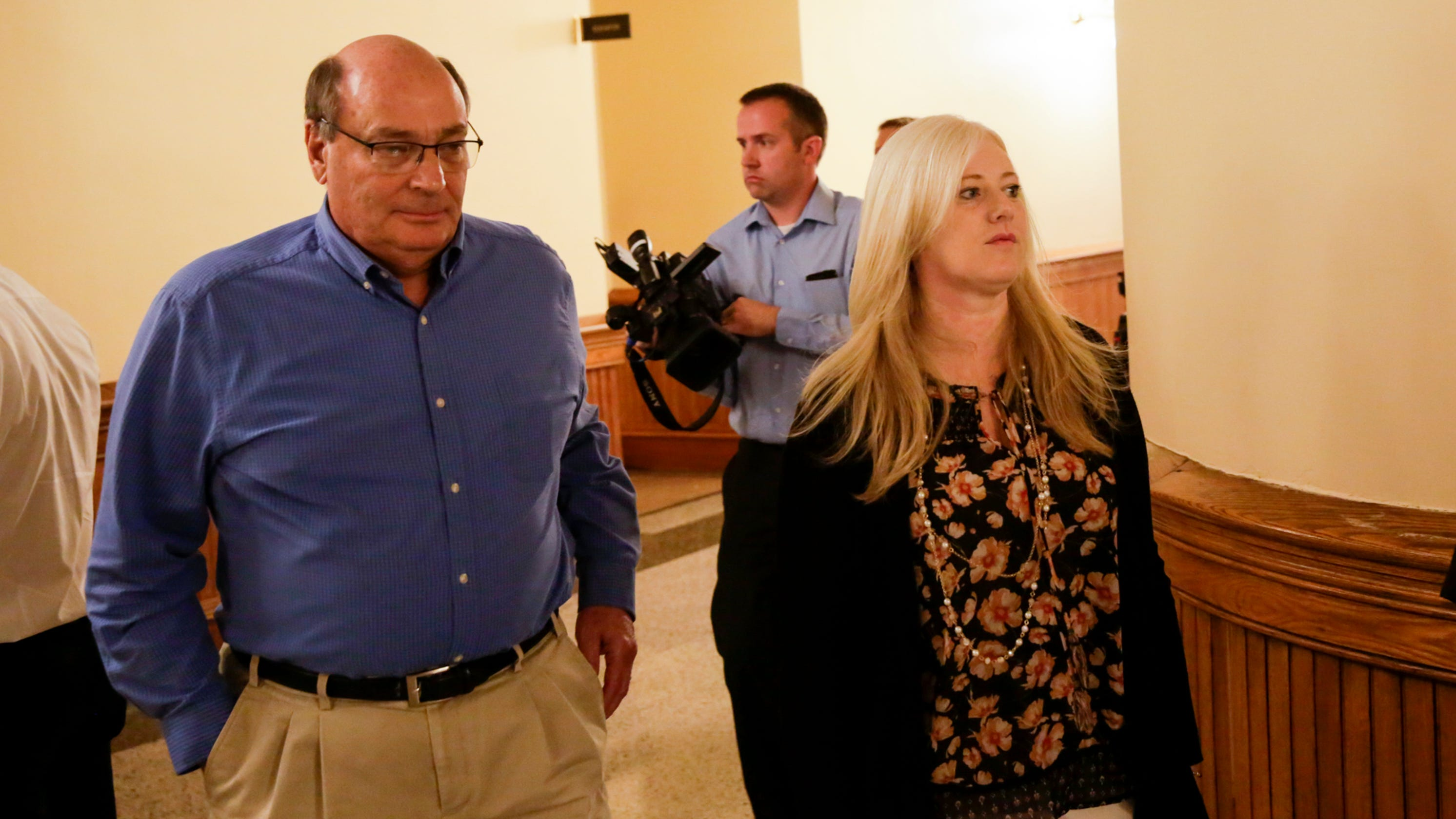 Parents accused of abandoning daughter, changing her age, plead not guilty